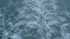 Wake of a cruise ship going through a Greenland channel. (Tilt) Stock Footage