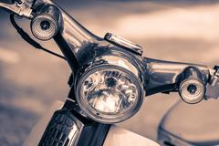 Vintage headlight lamp motorcycle - stock photo