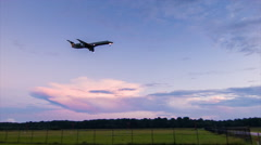 Unmarked Regional Jet Airliner Arriving and Landing at Dusk or Dawn Stock Footage