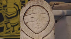 Carving of a traditionally dressed inuit on display. Stock Footage