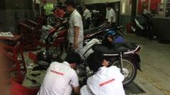 Vietnamese moto service Honda Stock Footage