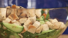 Someone adding dressing to a chicken salad. - stock footage