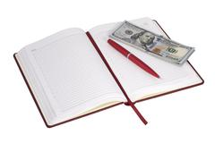 Open notebook and money - stock photo