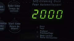 An oven timer counts down to zero from twenty. - stock footage