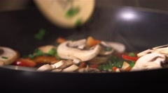 Sauteeing mixed vegetables in a frying pan. Stock Footage