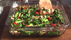 Vegetables being spread out along the base of a pan. Stock Footage