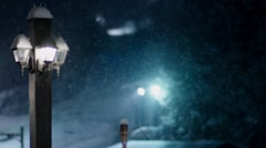 Light post rack focuses to a Chairlift at a ski resort during a snowy night. Stock Footage