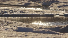 Melt pond formed on sea-ice in Arctic Bay. - stock footage