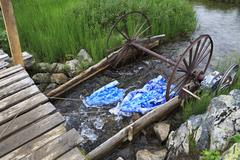 Adaptation for washing linen in a mountain river - stock photo