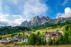 Stock Photo of Cristallo Mountains with alpine village, Dolomites