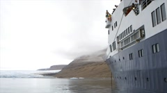 Slow motion shot of a man jumping from a cruise ship into freezing arctic water. Stock Footage