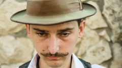 Man looking through a monocle Stock Footage