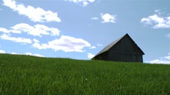 Old wood barn on top of a grassy hill. Stock Footage