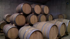 Barrels of wine aging in a cellar. - stock footage