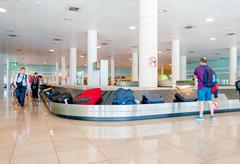 BARCELONA, SPAIN - 8 AUGUST, 2015: Conveyer belt for arrivals luggage with Stock Photos