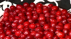 Cranberries being poured into a bowl. - stock footage