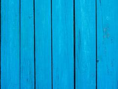 Wooden fence blue background - stock photo