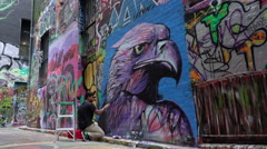 Street artist creating graffiti - stock footage