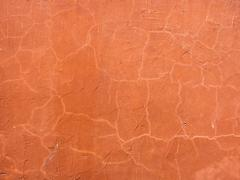 Brown orange plastered wall surface - stock photo