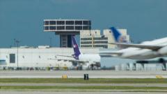 Houston TX Airport Scene with Airliner Taking Off in Foreground Stock Footage
