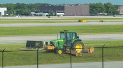 Airport Grass Cutting by Farm Machinery in Houston TX IAH Stock Footage