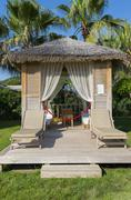 Traditional summerhouse on  tropical resort - stock photo