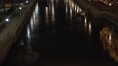 Partially frozen Rideau Canal at night. (Tilt Up) Stock Footage