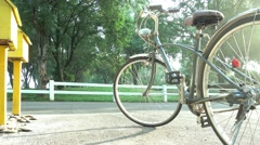 Dolly shot a bicycle in the morning sunshine in front of letter boxes, 4K Stock Footage