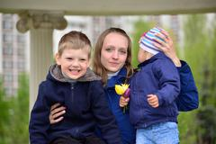 Mother with two children on a walk in  gazebo - stock photo