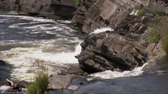 Small waterfall and river in Hogs Back Park, Ottawa, Ontario. - stock footage