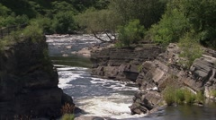 Small waterfall and river in Hogs Back Park, Ottawa, Ontario. Stock Footage