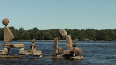 Statues of skillfully balanced stone along the Ottawa River. Stock Footage