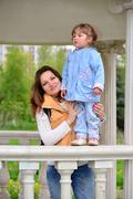 Mom and daughter 2.5 years for a walk in  gazebo - stock photo