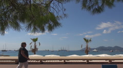 Beautiful Cannes port panorama luxury yacht tourist people relax french resort  Stock Footage
