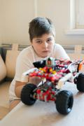 Boy plays collects from the constructor of  car Stock Photos