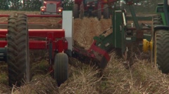 Tractors harvesting potatoes in a field. Stock Footage