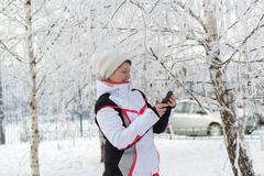 Sport middle-aged woman writes sms Kuvituskuvat
