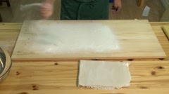 Man preparing a cutting board to create soba noodles. Stock Footage