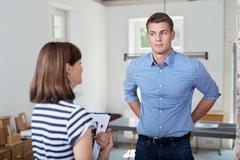 Businessman Listens to his Female Manager Talking Kuvituskuvat