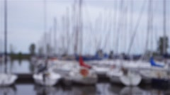Sail boats docked at a harbour. - stock footage