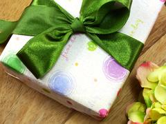 Gift box close up on wooden background Stock Photos
