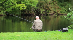 Old fisherman on the pond Stock Footage