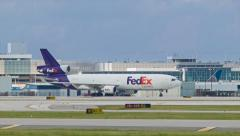 FedEx MD11 F Cargo Airplane Transporter Arriving in Houston Stock Footage