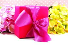 Colored gift boxes with decorative bows isolated on white background Stock Photos