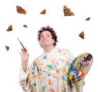 Happy painter is inspired butterfly when painting Stock Photos