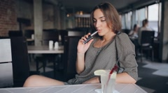 Girl with E-cigarette Stock Footage