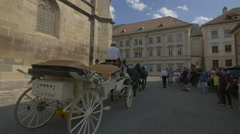 Beautiful carriage with four horses in Honterus Square (Curtea Honterus), Brasov Stock Footage