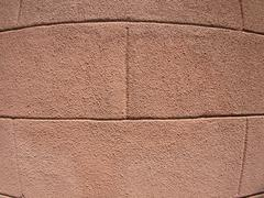 Detail of a decorative wall with a rough coating of cement Stock Photos