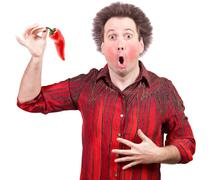 Man holding a spicy red paprika Stock Photos