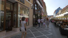 Republicii street, a shopping street with stores and restaurants, Brasov Stock Footage